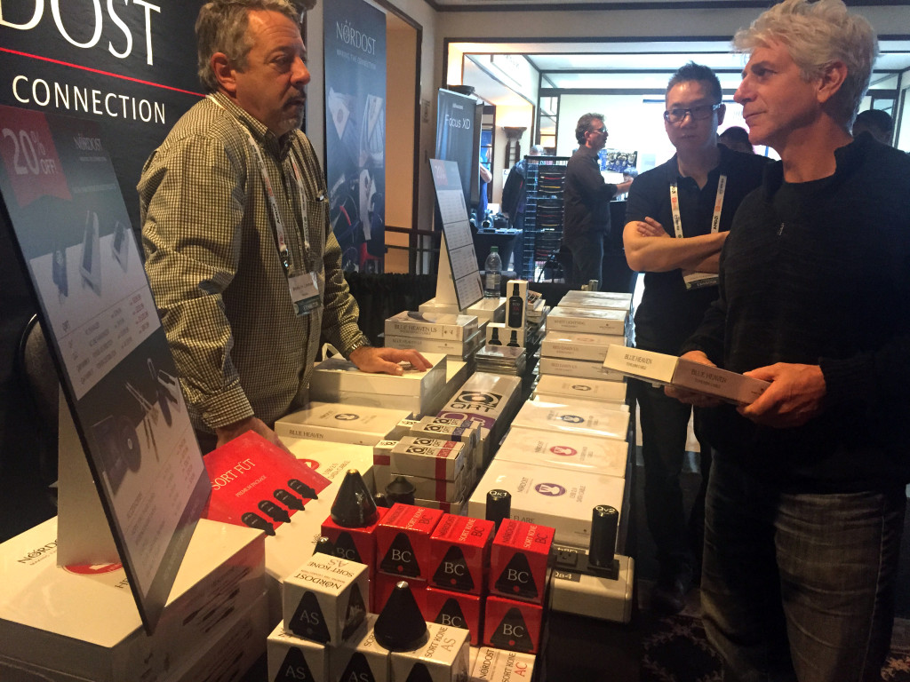 Bruno de Lorimier talks with customers at the Nordost booth